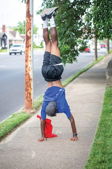 Tayvho doing a headstand