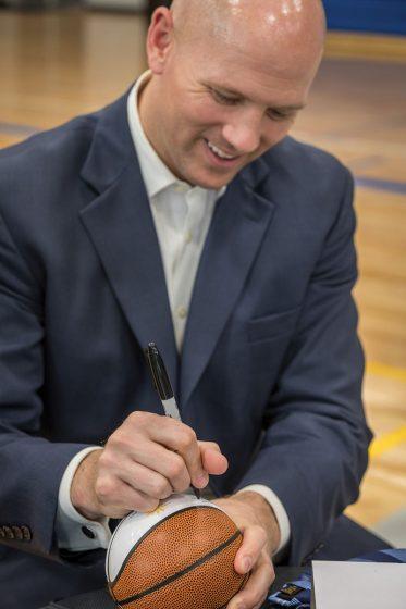Signing a basketball