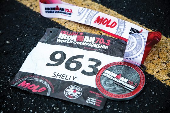 Shelly Hammons' Ironman 70.3 World Championship bib number and medal
