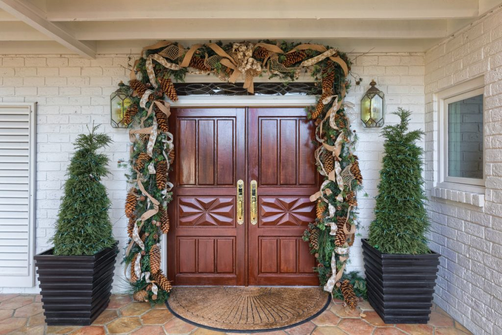 Front doors of home decorated for Christmas
