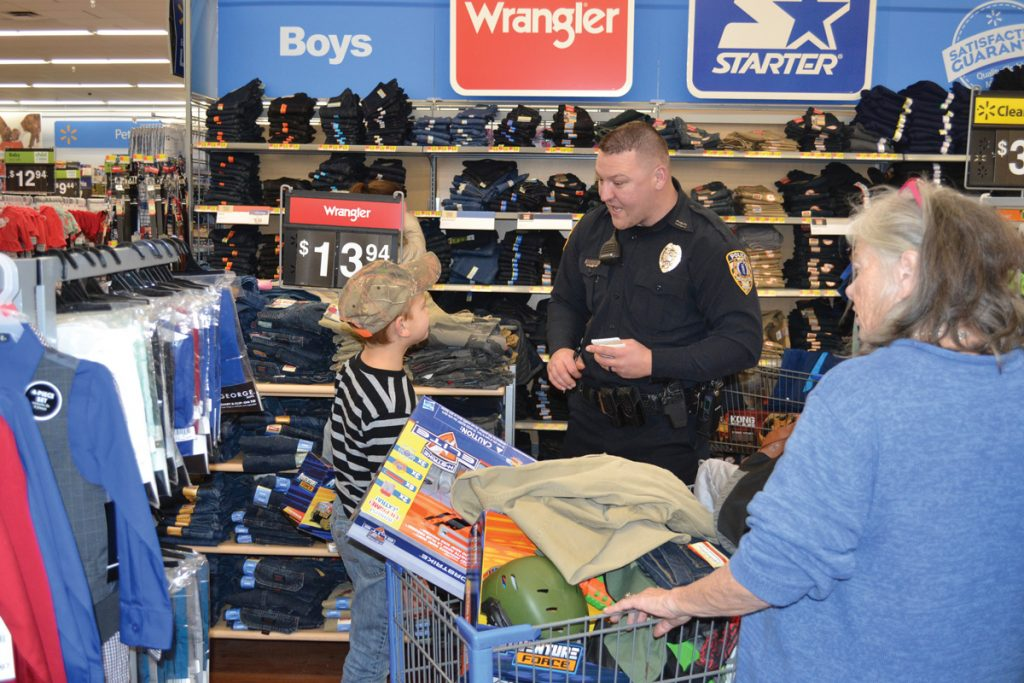 Boy and Policeman during Shop With a Cop