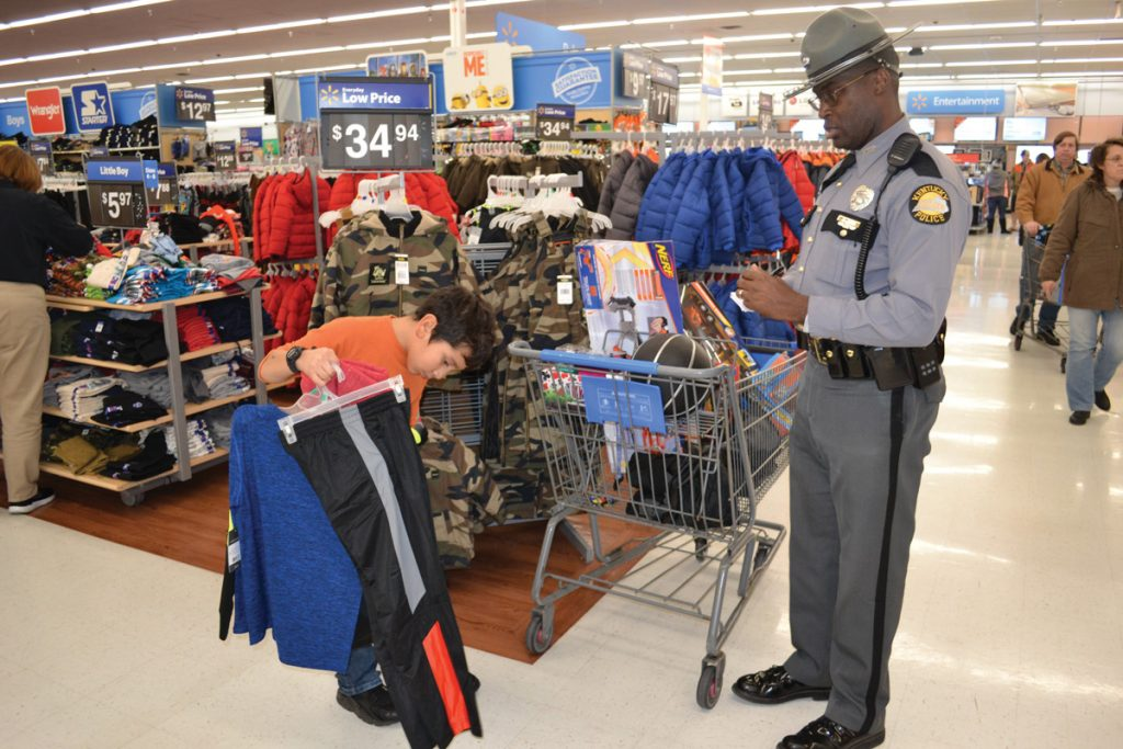 Boy and State Trooper during Shop With a Cop