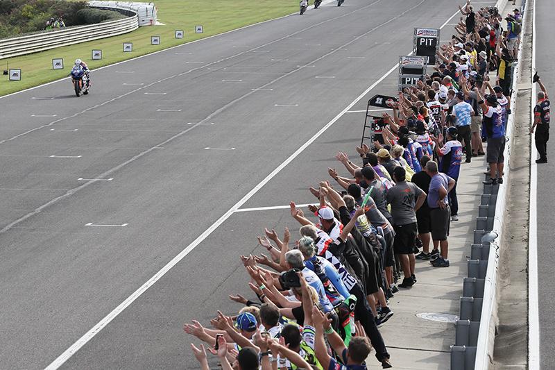 Fans cheering for racer Roger Lee Hayden on the racetrack