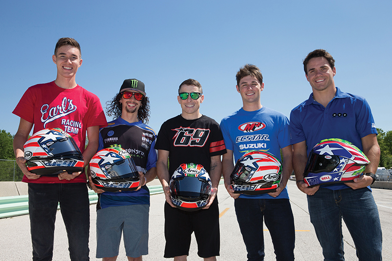 (L-R) Jake Lewis, JD Beach, Roger Hayden, Nick McFadden, and Hayden Gillim hold their Nicky Hayden replica helmets which they all wore in tribute to Nicky during the 2017 Road America race in Elkhart Lake, Wisconsin. Photo by Brian J. Nelson.