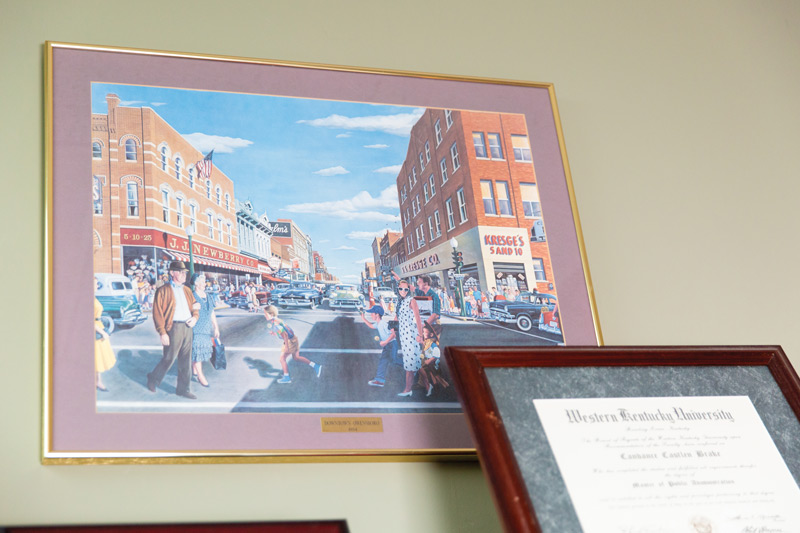 1954 painting of downtown Owensboro hang on display in Brake's office.