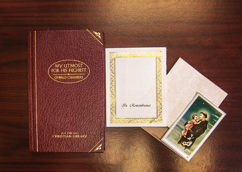 My Utmost for His Highest book and Candance's grandfather's funeral program laying on desk