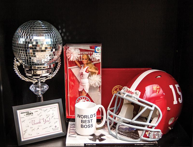 mirror ball, World's Best Boss coffee mug, and University of Alabama memorabilia