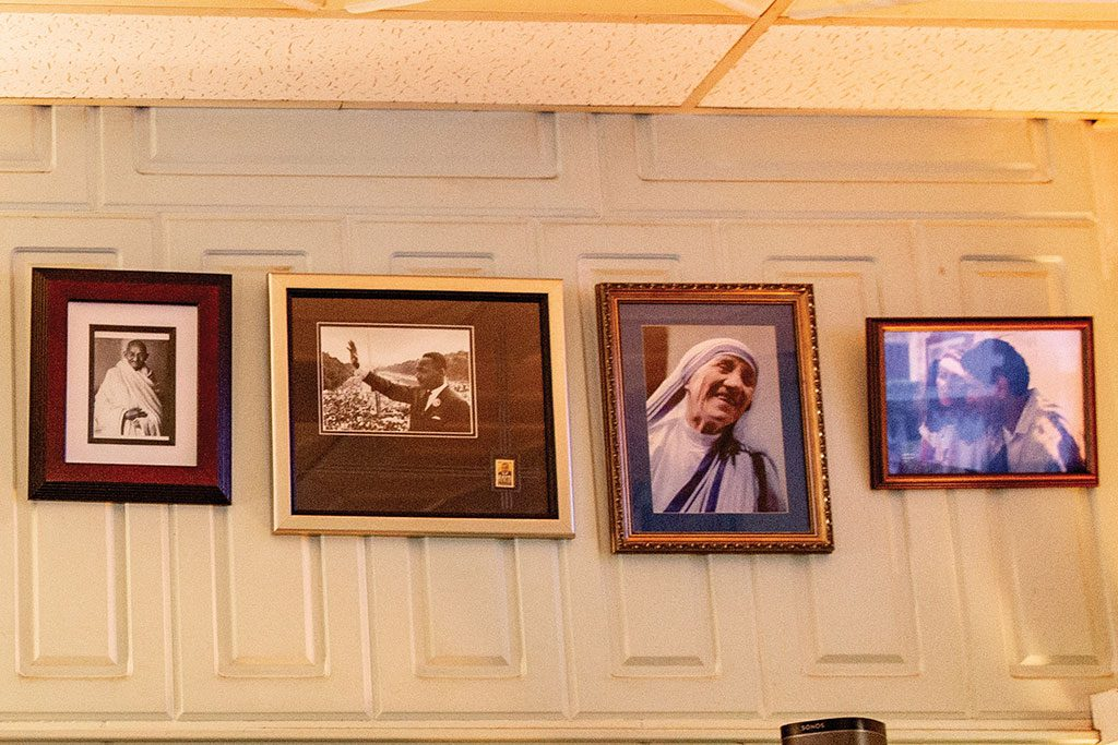 Images of Mahatma Gandhi, Dr. Martin Luther King Jr., and Mother Theresa hang in the restaurant.