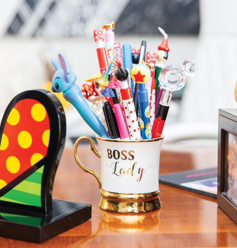 Coffee mug filled with Disney pens on Dr. Suzanne Rashidian's desk