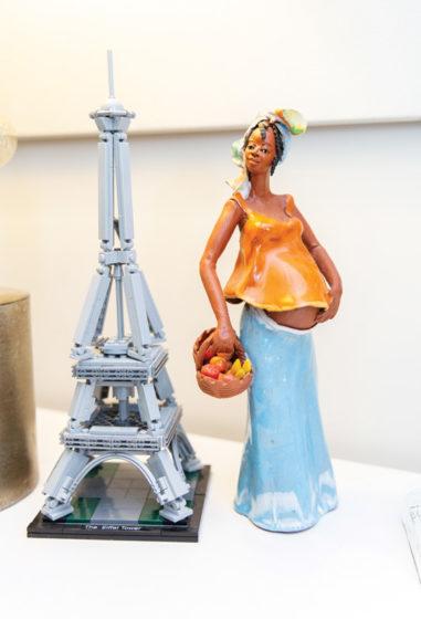 Lego Eiffel Tower besude a pregnant Jamaican lady figurine