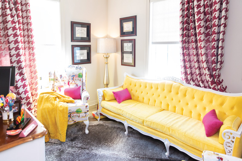 Bright yellow couch in Dr. Suzanne Rashidian's office
